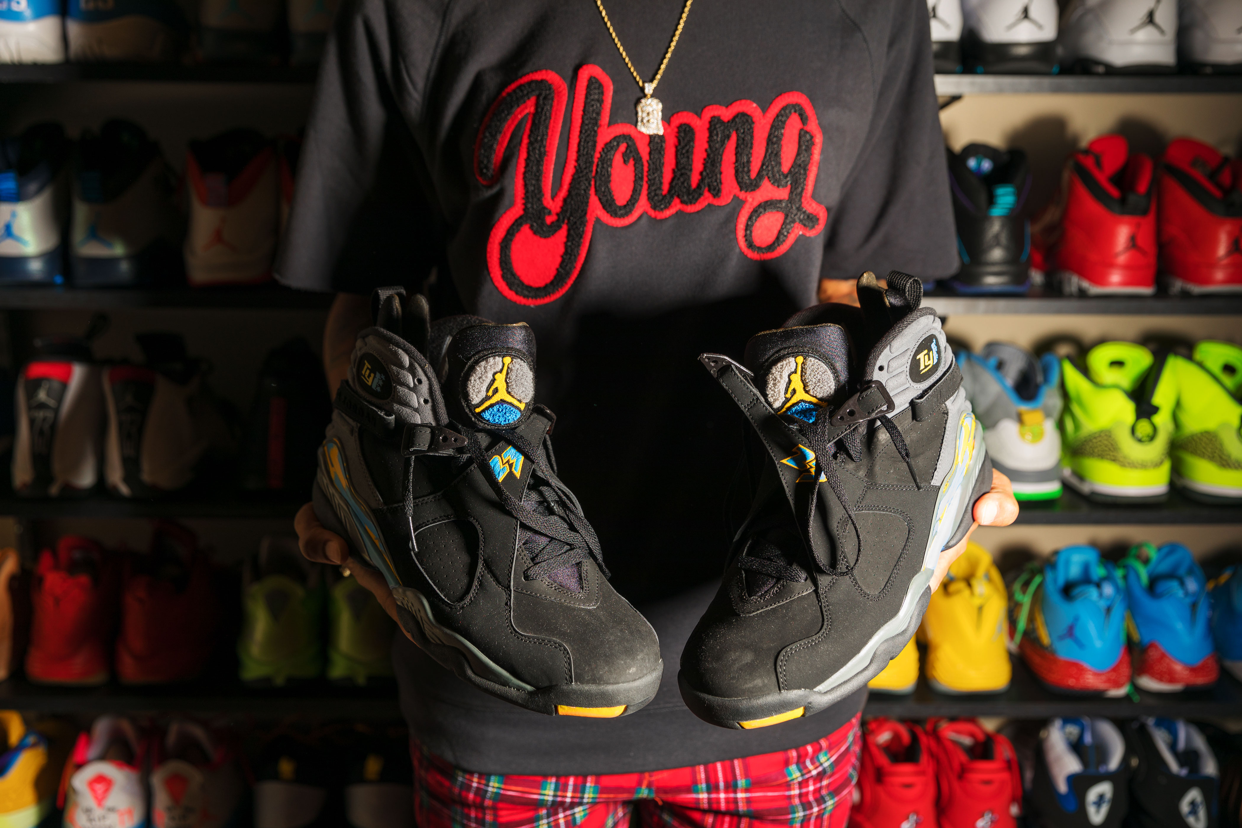 43b7e42e4039da TY Young holds up a pair of Jordans in her Atlanta home. She and Michael  Jordan share a hometown (Wilmington