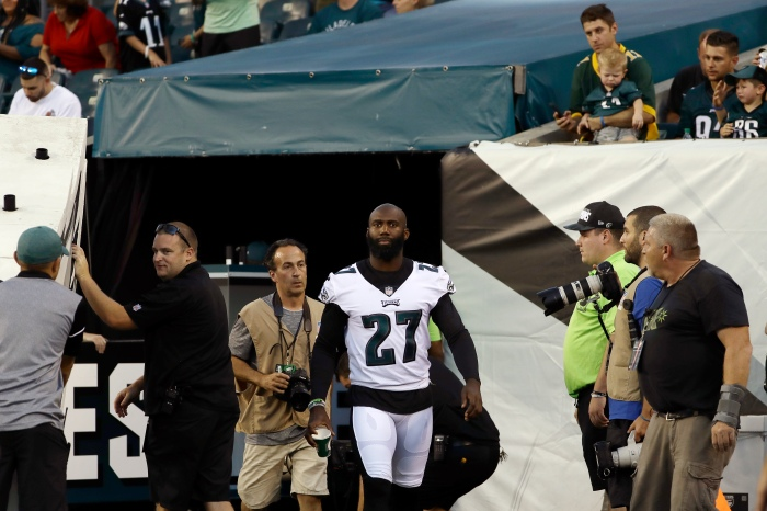 The Philadelphia Eagles  Malcolm Jenkins walks onto the field from the  locker room after the national anthem before the team s preseason NFL  football game ... 121145b69