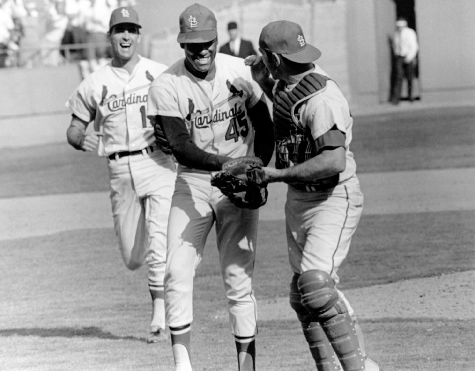 90b8e2c225b St. Louis Cardinals pitcher Bob Gibson (center) is congratulated by catcher  Tim McCarver (right) during the 1968 World Series against the Detroit  Tigers.