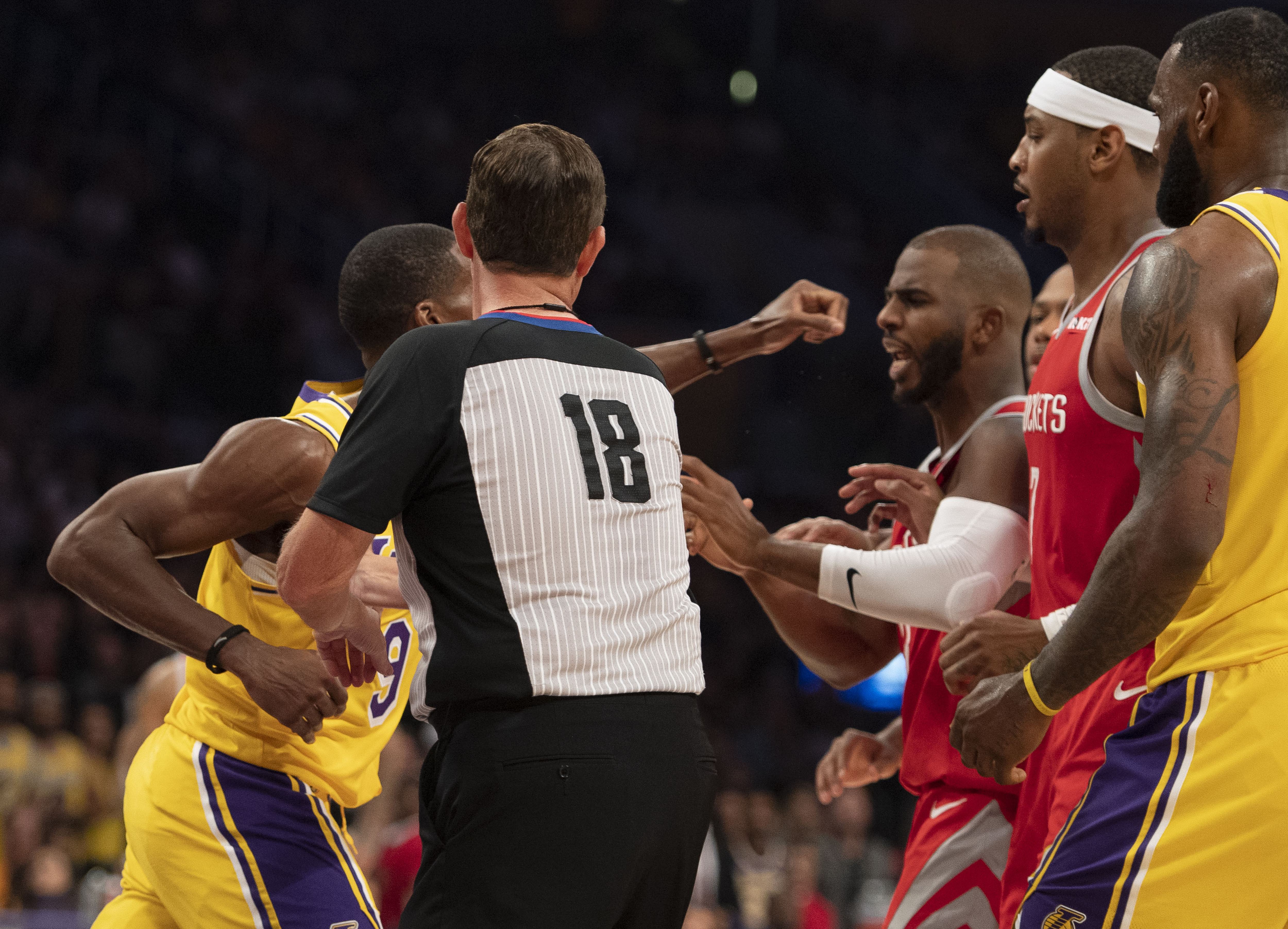 ded56d54c808 Rajon Rondo (left) of the Los Angeles Lakers punches Chris Paul (right) of  the Houston Rockets as referee Matt Boland (center) tries to break it up  during ...