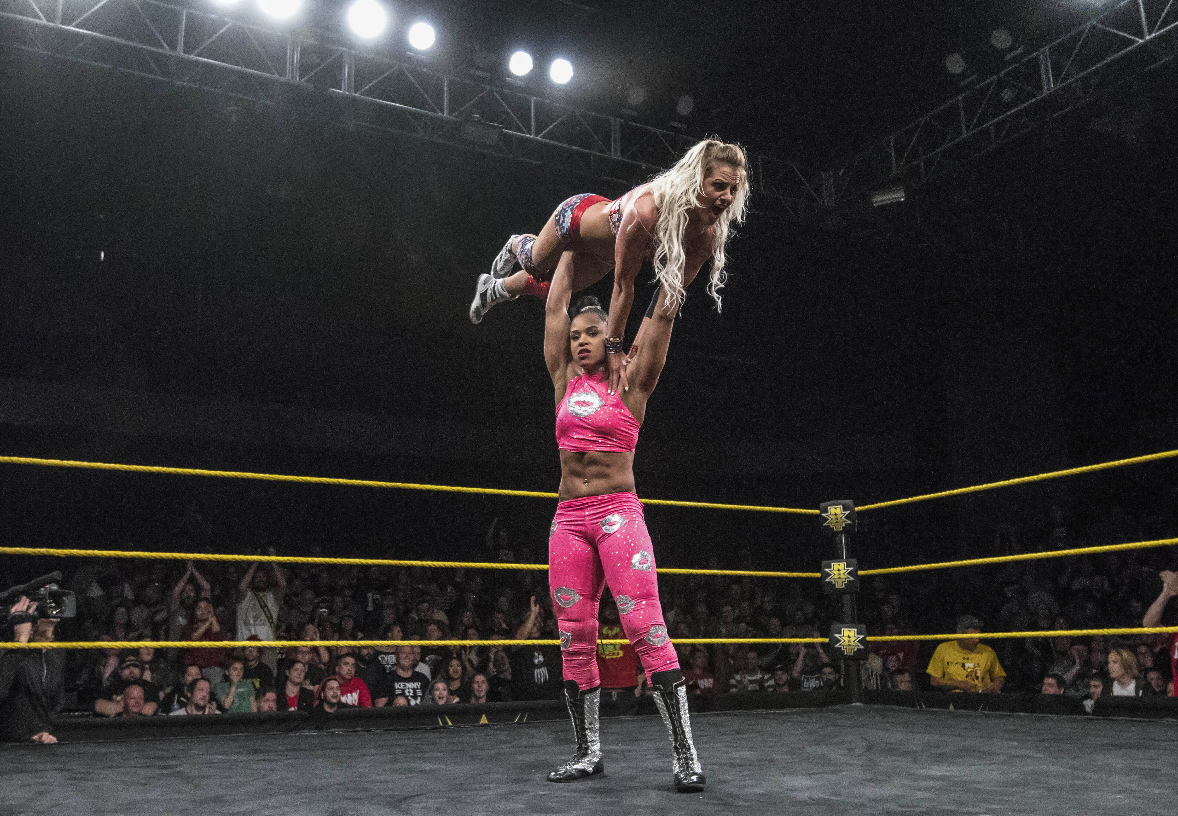 huge selection of 7cf86 2f8c9 Bianca Belair lifts Candice LeRae over her head during a NXT taping at Full  Sail University. Courtesy WWE
