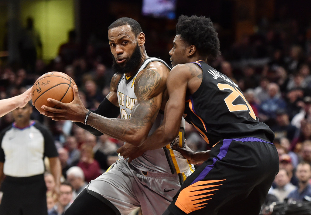 49e9f505ec7 Then-Cleveland Cavaliers forward LeBron James (left) drives to the basket  against Phoenix Suns guard Josh Jackson during the first half of a game in  March ...