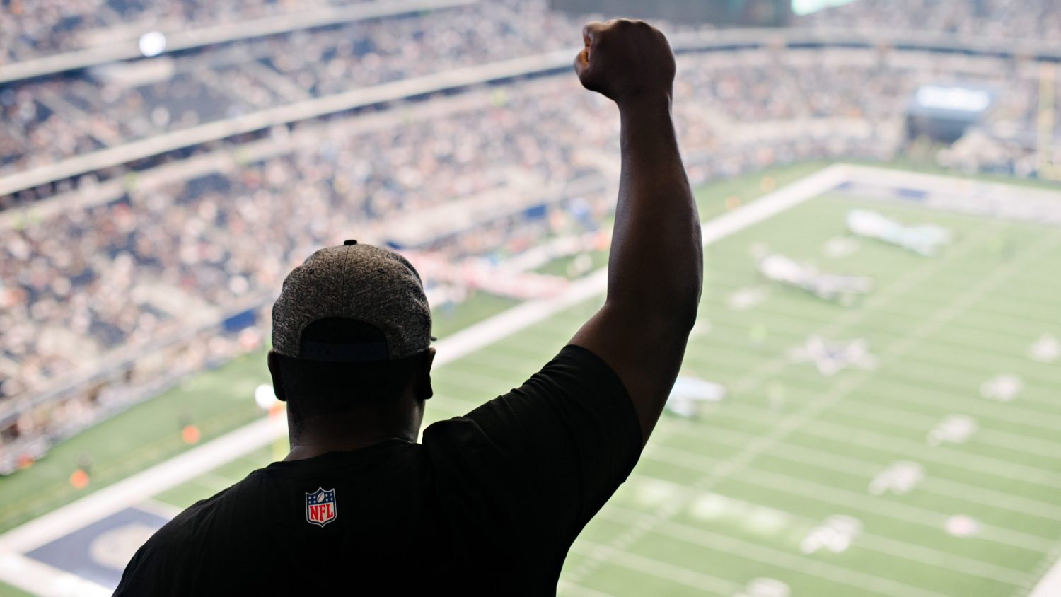 9a19c1057a5b We The Fans cast member Andrew Brown shows his sign of protest during the  national anthem at the Dallas Cowboys game against the Green Bay Packers on  ...