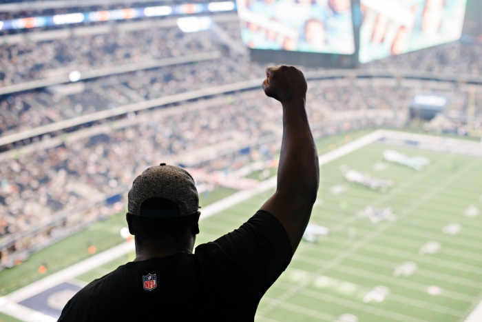 52c89cba446 Andrew Brown shows his sign of protest during the national anthem at the  Cowboys game against the Green Bay Packers on October 8, 2017.