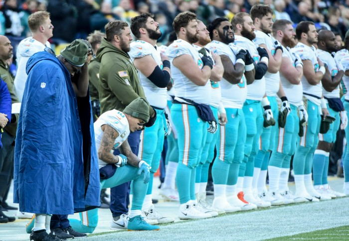 3f4926e4b Miami Dolphins wide receiver Kenny Stills kneels during the national anthem  before a game against the Green Bay Packers at Lambeau Field in Wisconsin.