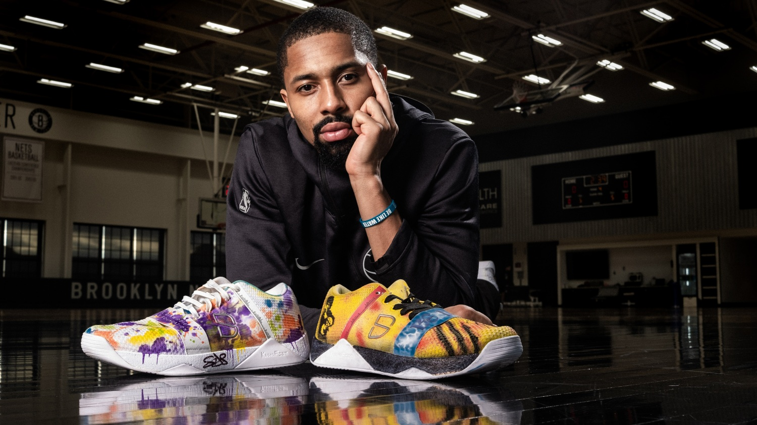 size 40 19e39 4ad70 Spencer Dinwiddie of the Brooklyn Nets poses with the Dinwiddie Family  Foundation custom sneaker (left) and on the right is the Bruce Lee custom.