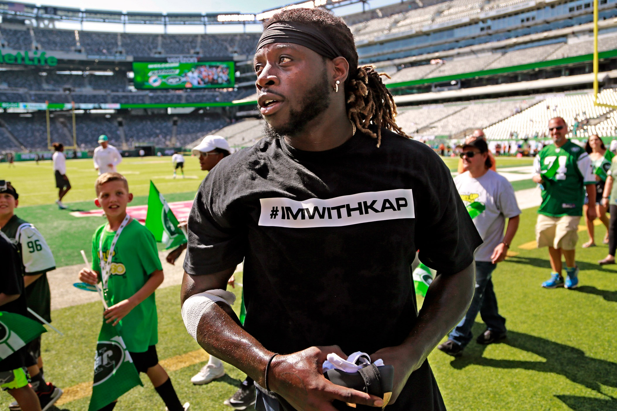 2e78ee69f19 Miami Dolphins running back Jay Ajayi (23) and several other Dolphin  players wear t-shirts in support of Colin Kaepernick before an NFL football  game as the ...