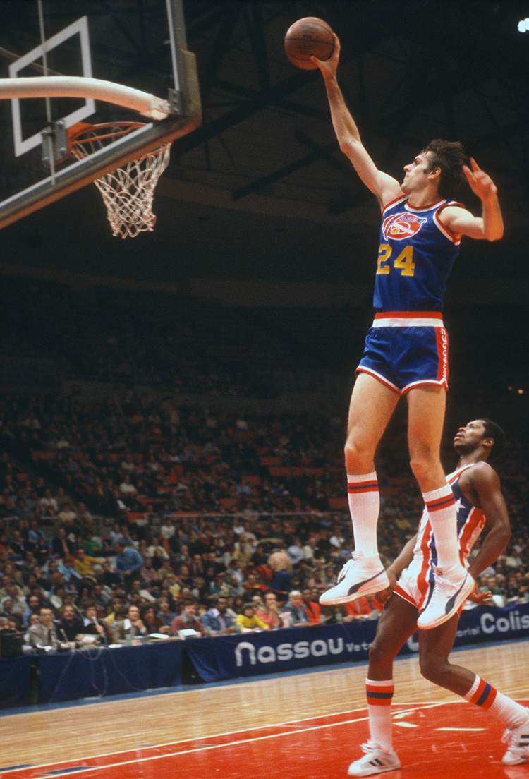 24) of the Denver Nuggets dunks the ball against the New Jersey Nets during  an NBA game in 1977. (Photo by Focus on Sport Getty Images) a746ffaa3