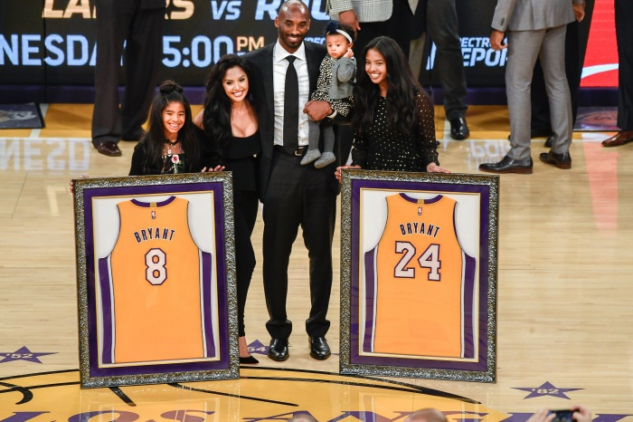 online store 6680b 0b4f4 Former Los Angeles Lakers player Kobe Bryant (center) and family pose for a  photo during a halftime ceremony to retire his two uniforms at Staples  Center.