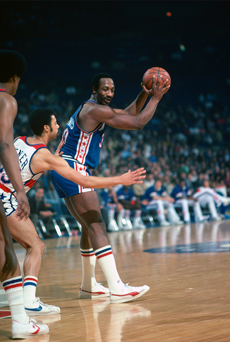 cheap for discount 5ddc0 8ad64 George McGinnis of the Philadelphia 76ers looking to pass the ball against  the Washington Bullets during an NBA game in 1978. (Photo by Focus on  Sport Getty ...