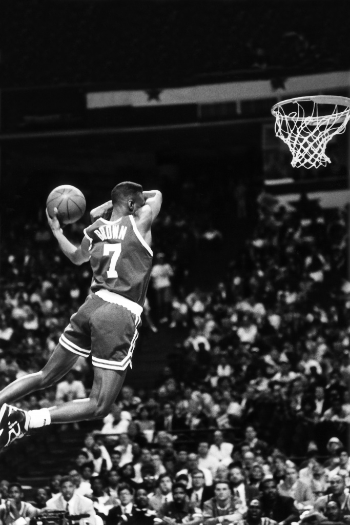 Dee Brown Of The Boston Celtics Goes Up For His No Look Dunk During 1991 NBA Slam Contest As Part All Star Weekend On Feb