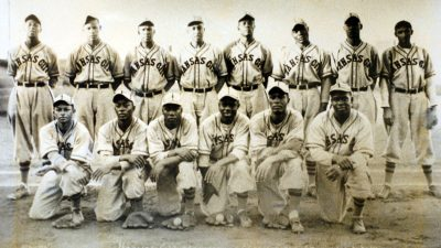 DENVER, COLORADO, DECEMBER 2, 2004–A 1939 team portrait of the Kansas City Monarchs, a Negro League team, that included Denver resident Byron Johnson , who is knealing at the bottom left,. Johnson is the oldest living Negro Leagues baseball player in Col