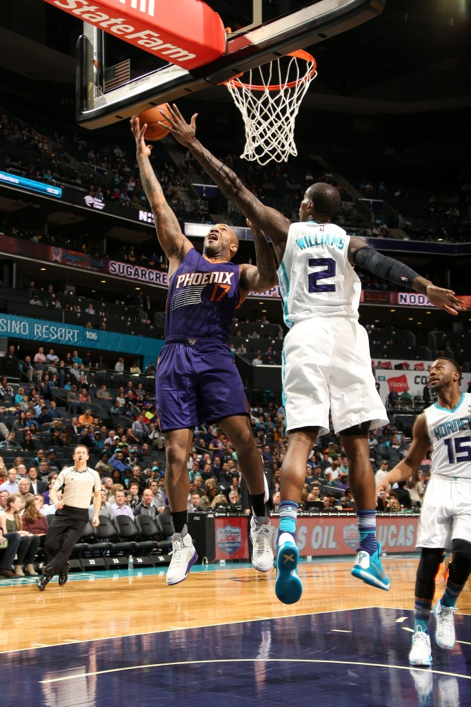 8c2ad2f7325d P.J. Tucker (left) of the Phoenix Suns goes to the basket wearing a pair of  rare Shawn Marion Air Jordan 5 PEs on March 1