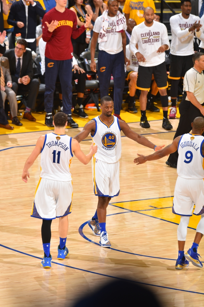 Harrison Barnes (center) high-fives Golden State Warriors teammates Klay  Thompson (left) and Andre Iguodala (right) during Game 7 of the NBA Finals  against ... 30868d4de