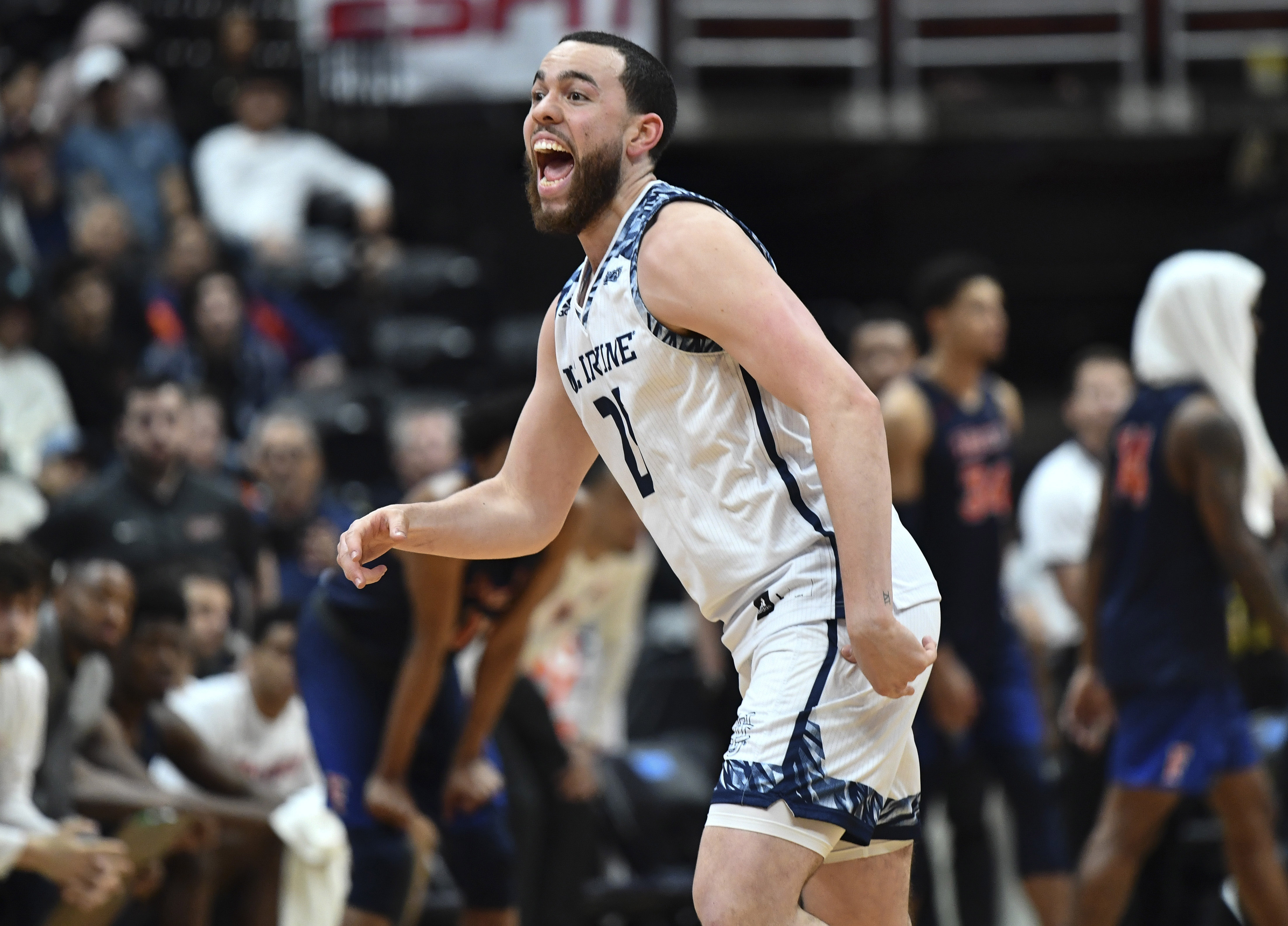 85ff39e50 UC Irvine guard Spencer Rivers celebrates the Anteaters  92-64 victory over  Cal State Fullerton in the finals of the Big West conference tournament at  Honda ...