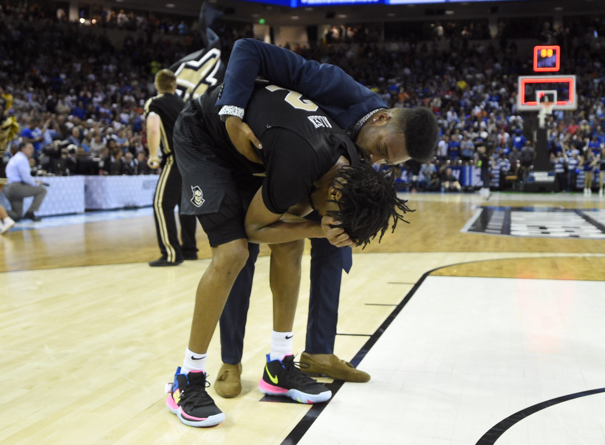 d170e0f4a9 UCF Knights guard Terrell Allen (center) reacts after being defeated by the  Duke Blue Devils in the second round of the 2019 NCAA tournament March 24  at ...