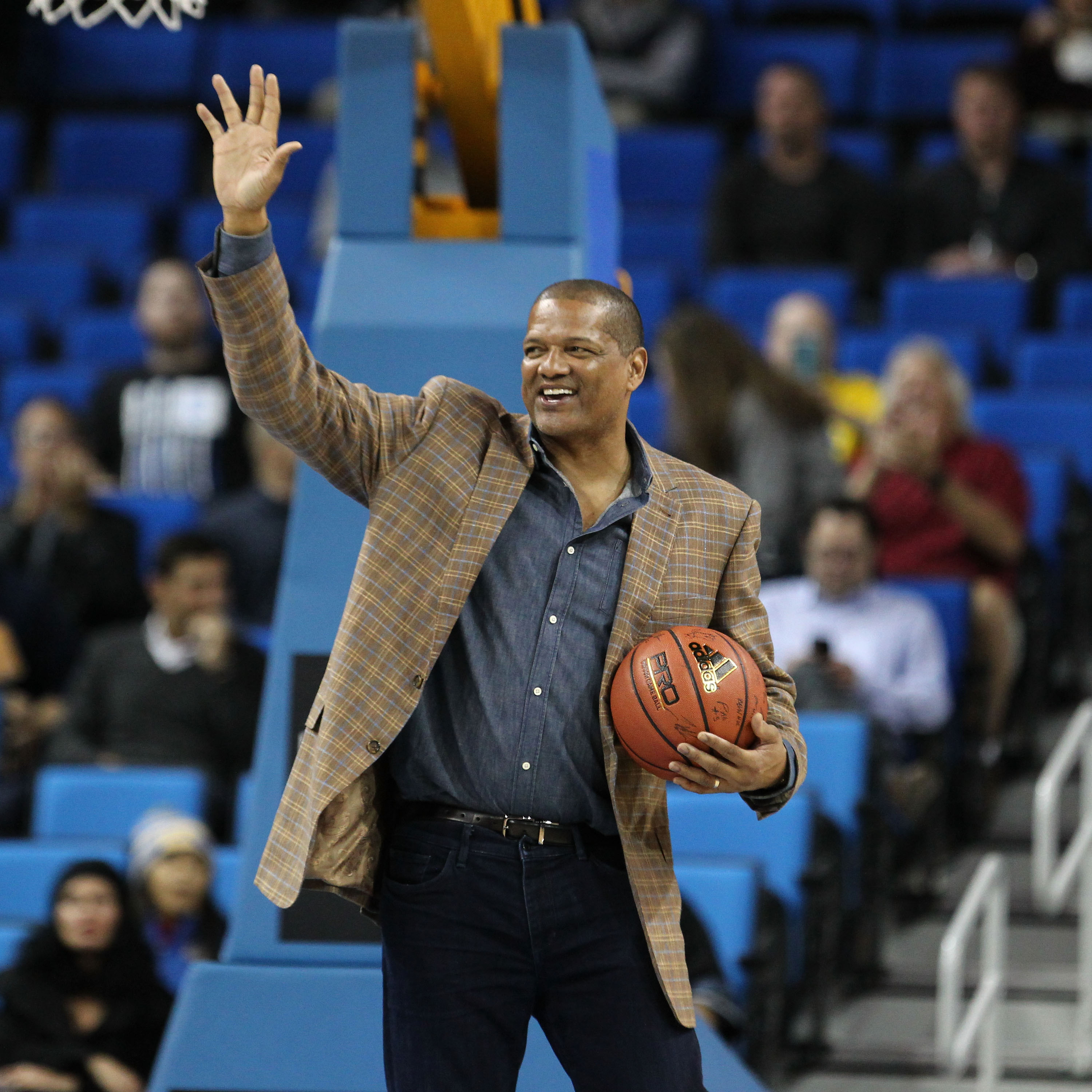 6e328325cd6 NBA UCLA alum Marques Johnson receives the game ball just before tip-off of  the Utah Utes vs. UCLA Bruins during a NCAA PAC12 college basketball game  at ...