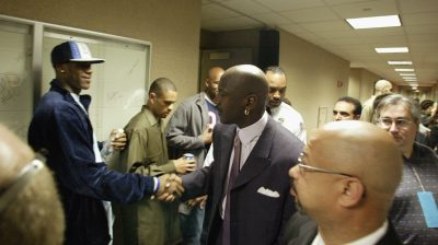 LeBron James shakes hands with Michael Jordan