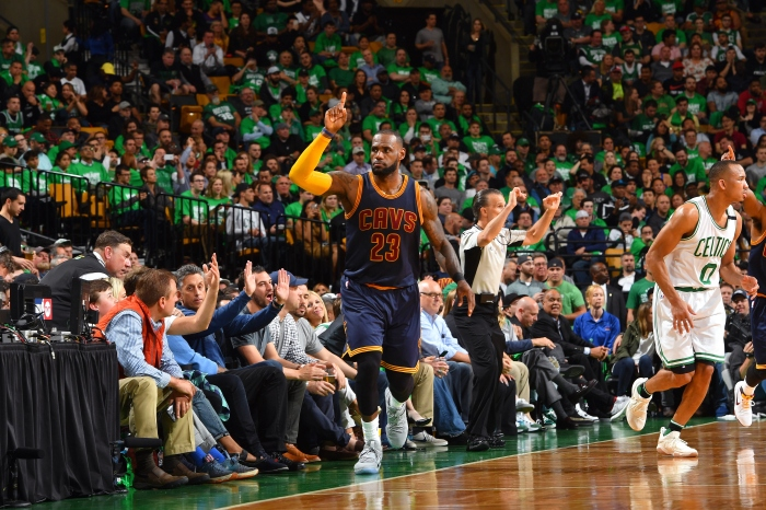 fc9a3c46c11 LeBron James celebrates after he hits a 3-pointer to pass Michael Jordan in  career playoff scoring during Game 5 of the Eastern Conference finals on  May 25, ...