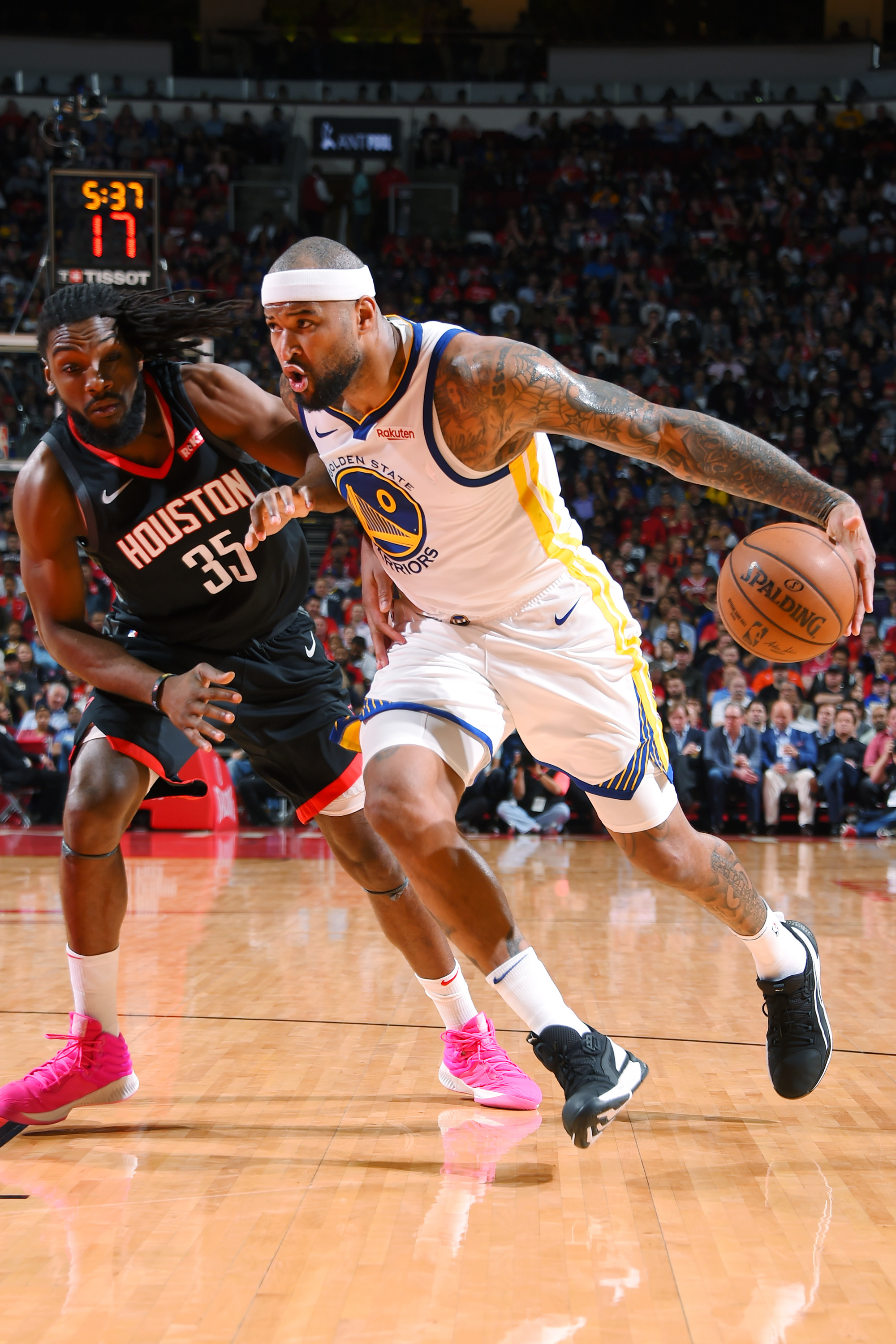 4a8ed43cb5b4 DeMarcus Cousins (left) drives to the basket against Kenneth Faried (left)  as the Warriors faced the Rockets at Houston s Toyota Center on March 13.