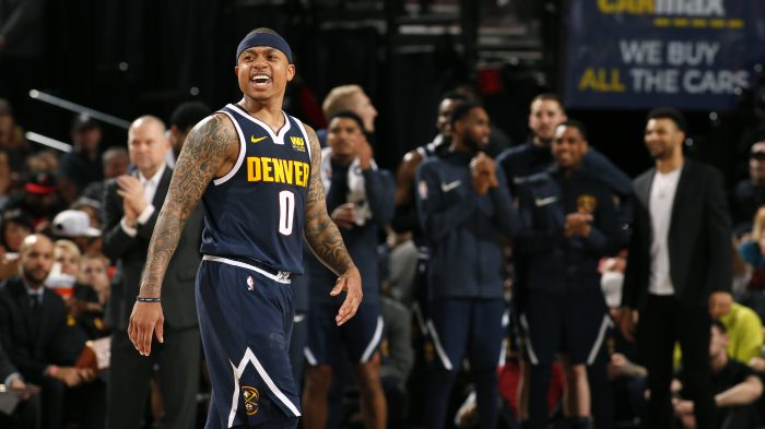 40dc1cebac18 Isaiah Thomas (left) of the Denver Nuggets reacts to a play during the game  against the Portland Trail Blazers on April 7 at the Moda Center Arena in  ...
