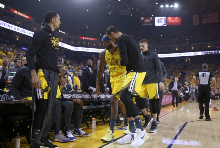 bd6e11840291 ... (center) is helped off the court after suffering a quadriceps injury  against the Clippers on April 15. Golden State coach Steve Kerr described  Cousins  ...