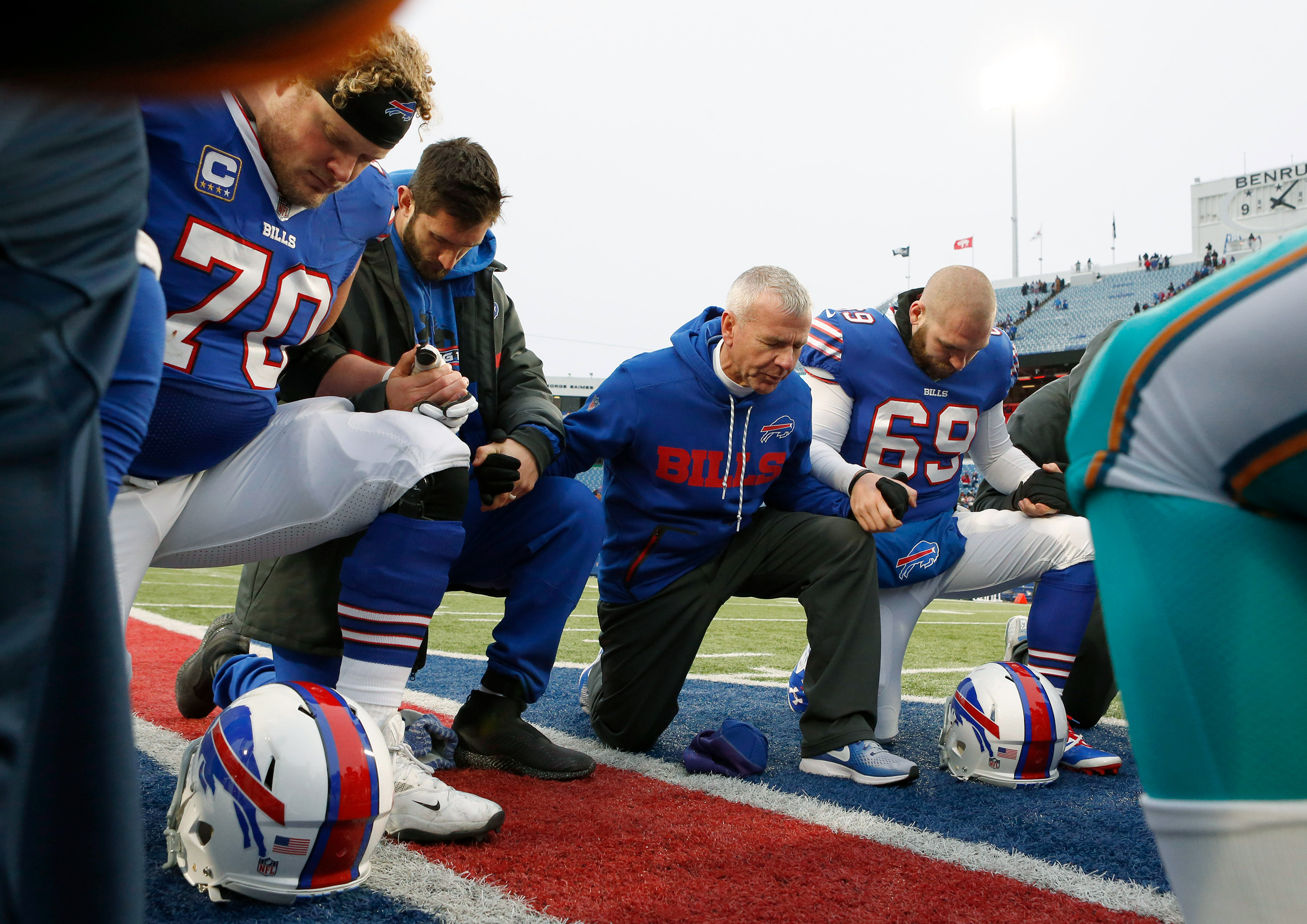 89de2c26c6a2 Buffalo Bills Chaplain Len Vanden Bos leads a prayer on the field after a  game against the Miami Dolphins at New Era Field. Buffalo beats Miami 24 to  16.