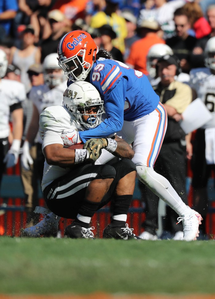 f3e643c3951cbd Florida defensive lineman Jachai Polite tackles Idaho running back Isaiah  Saunders during a game at Ben Hill Griffin Stadium in Gainesville