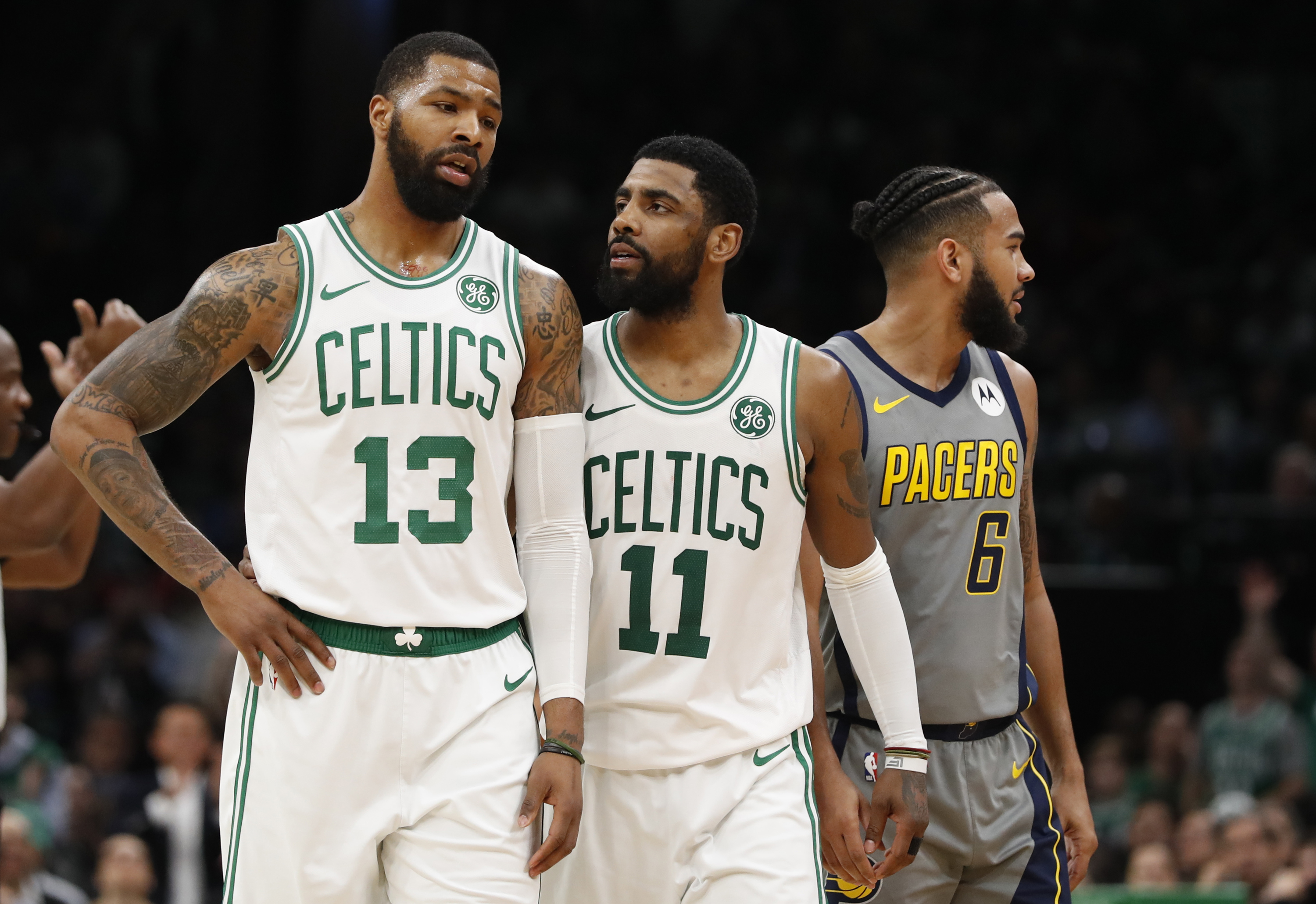 1dd4114467d Boston Celtics guard Kyrie Irving (center) talks with forward Marcus Morris  (left) after a play against the Indiana Pacers in the second half of a ...