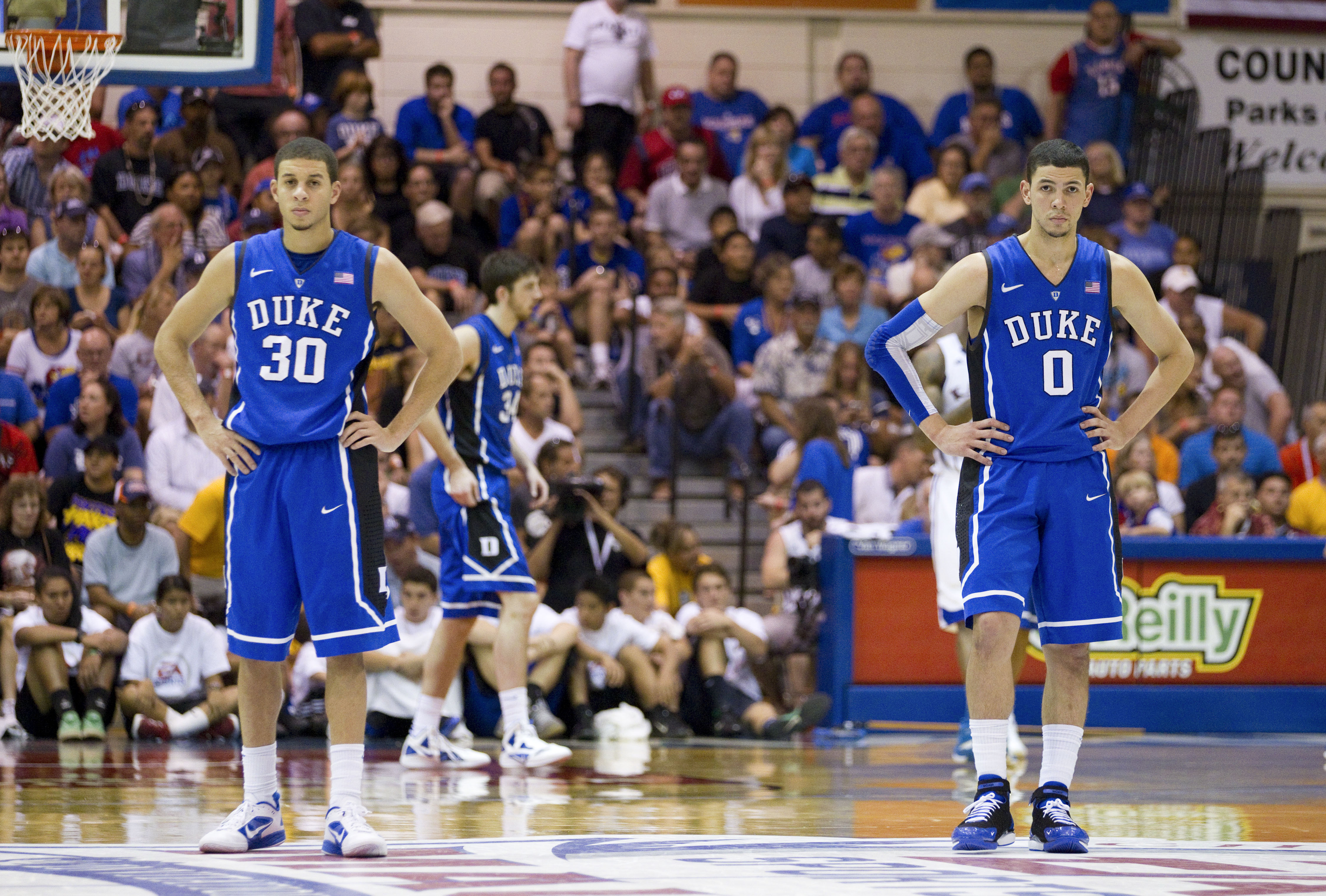 2868cdaaf380 Duke guard Seth Curry (left) and guard Austin Rivers (right) wait for the  start of play after a timeout in the first half of an NCAA college  basketball game ...