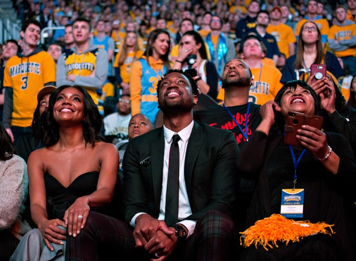 06a98f97669c Marquette alumni Dwyane Wade (center) is honored with Dwyane Wade Day  during halftime as Marquette takes on Providence for an NCAA college  basketball game ...