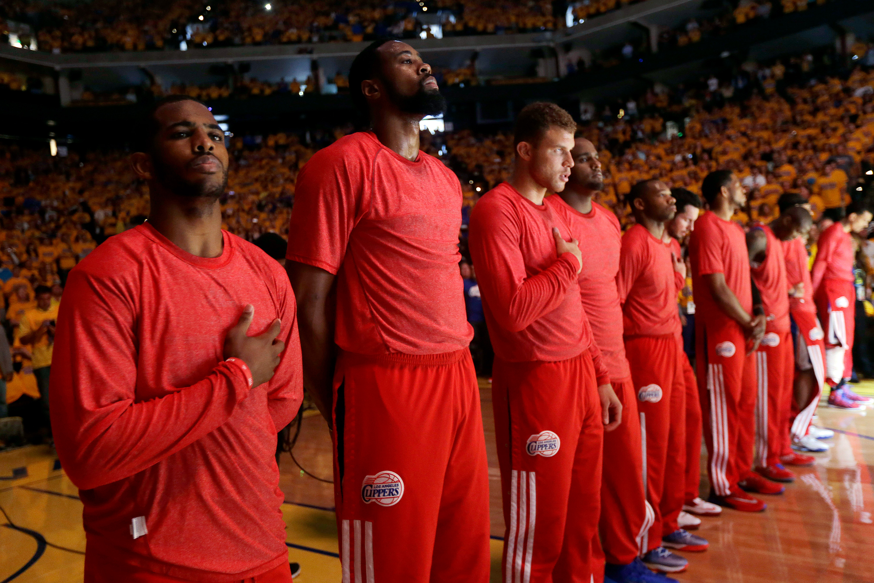 e08039f4dae441 Members of the Los Angeles Clippers listen to the national anthem before  Game 4 of an opening-round NBA basketball playoff series against the Golden  State ...