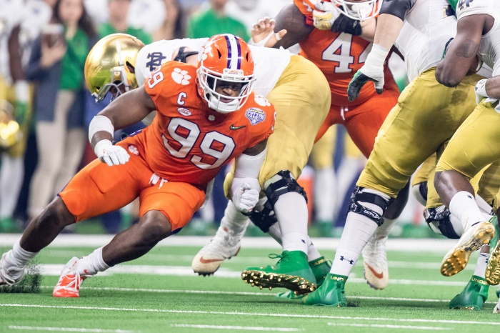11b5093a84e4 Clemson Tigers defensive end Clelin Ferrell works around a Notre Dame block  during the Goodyear Cotton Bowl College Football Playoff semifinal game  against ...