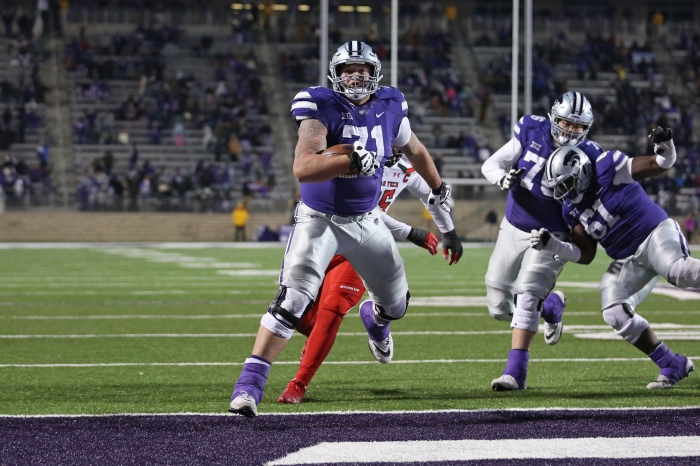 b4d41972 Kansas State Wildcats offensive lineman Dalton Risner (center) scores a  touchdown late in a Big 12 football game against the Texas Tech Red Raiders  on Nov.
