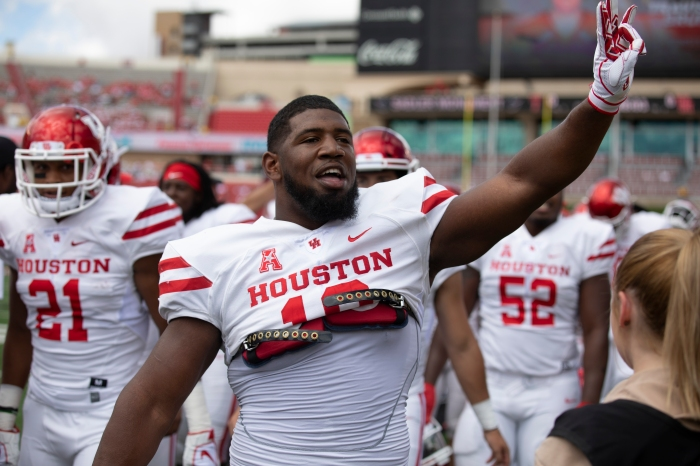 4884cb9bd28 Houston s Ed Oliver responds to the student section before a game versus  Texas Tech on Sept. 15