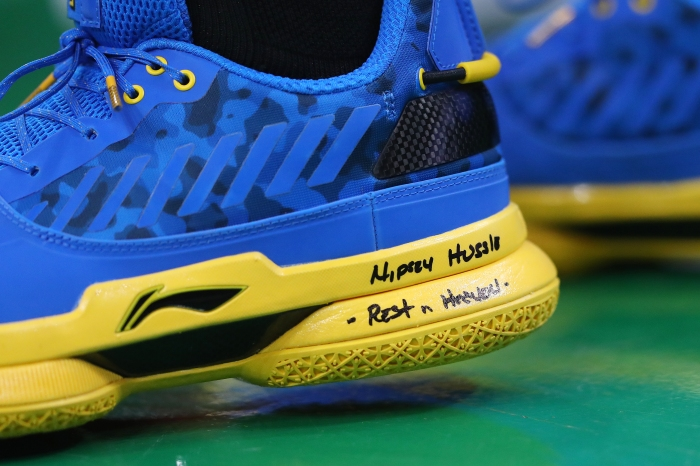 wholesale dealer 25219 c0d21 The sneakers worn by Dwyane Wade with a message commemorating rapper Nipsey  Hussle, who was shot and killed on March 31, before a game between the  Miami ...