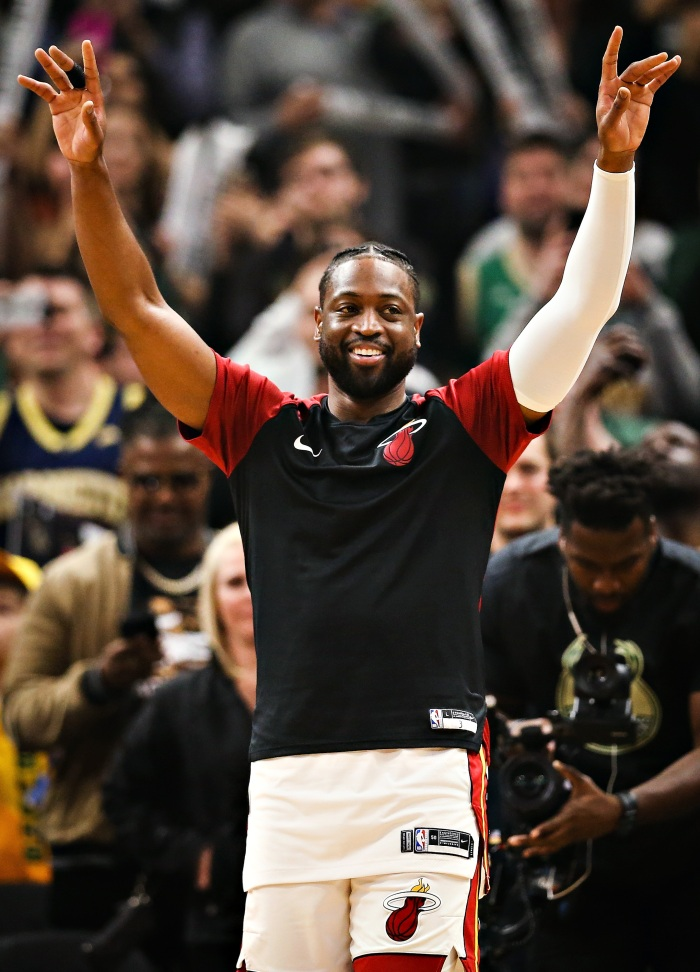 c13567c40b25 Dwyane Wade acknowledges the crowd while being honored in the first quarter  against the Milwaukee Bucks at the Fiserv Forum on March 22 in Milwaukee.