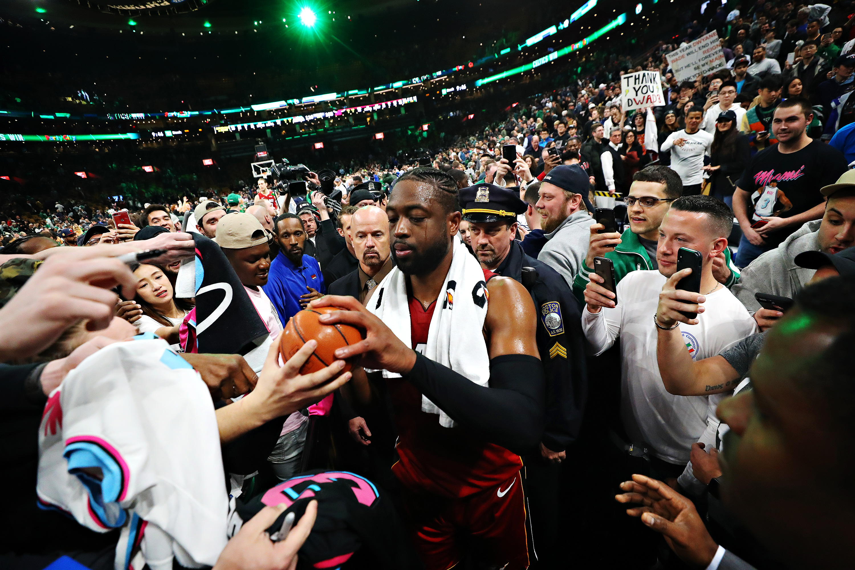 5f51b6e793d4 Dwyane Wade signs autographs after his final game at TD Garden April 2 in  Boston. The Celtics defeated the Heat