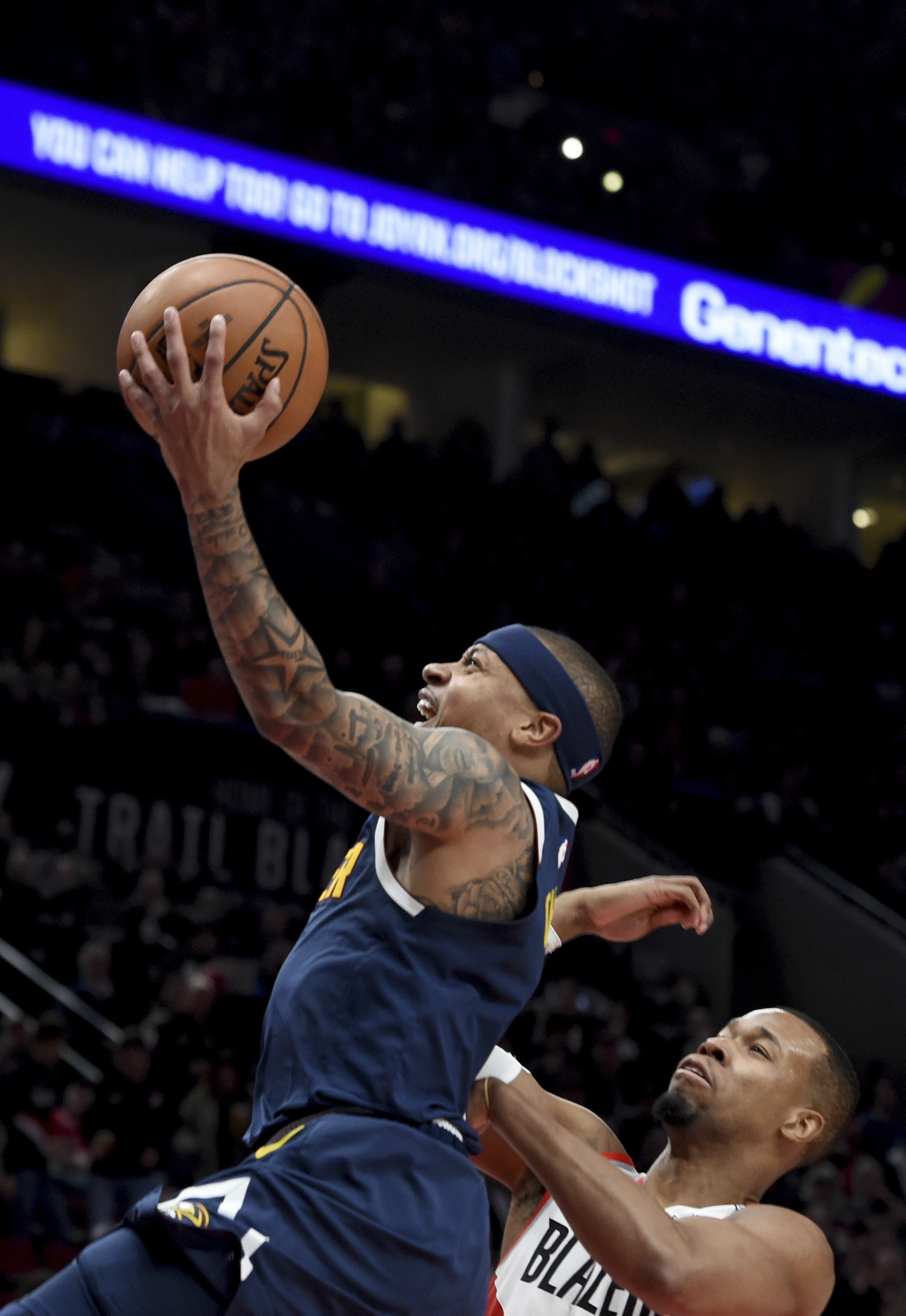f5b402459ce Denver Nuggets guard Isaiah Thomas (left) drives to the basket on Portland  Trail Blazers guard Rodney Hood (right) during the first half of an NBA ...