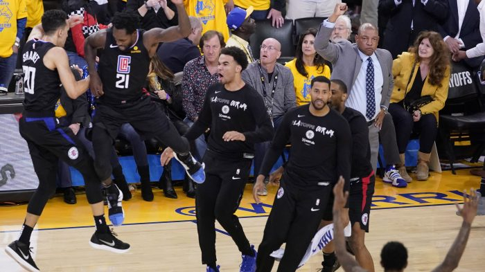 5ec6cb59 Los Angeles Clippers guard Landry Shamet (left) celebrates with teammate  (second left, No. 21) after Shamet sank the eventual game-winning 3-pointer  against ...