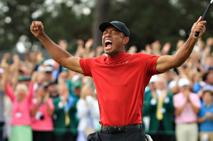 c23f88c54857c Tiger Woods celebrates after sinking his putt to win during the final round  of the Masters at Augusta National Golf Club on April 14 in Augusta,  Georgia.