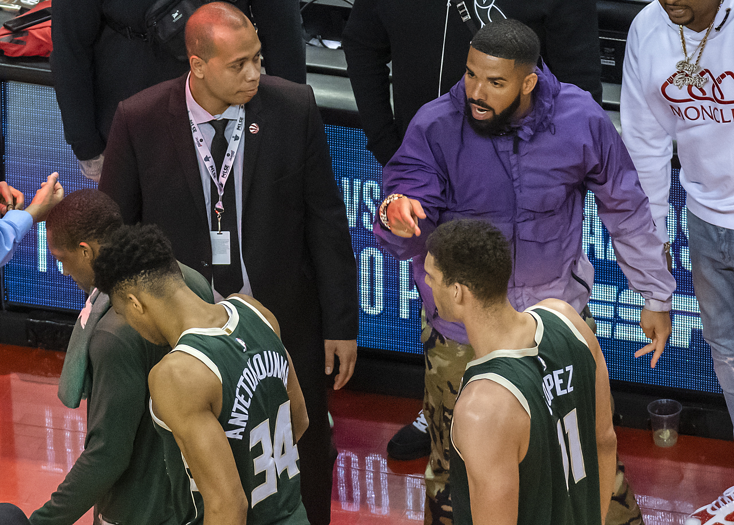469e8473789 Canadian rap artist Drake (R, rear) yells at Milwaukee Bucks forward  Giannis Antetokounmpo (L, front) after the NBA Eastern Conference Finals  Game 3 ...