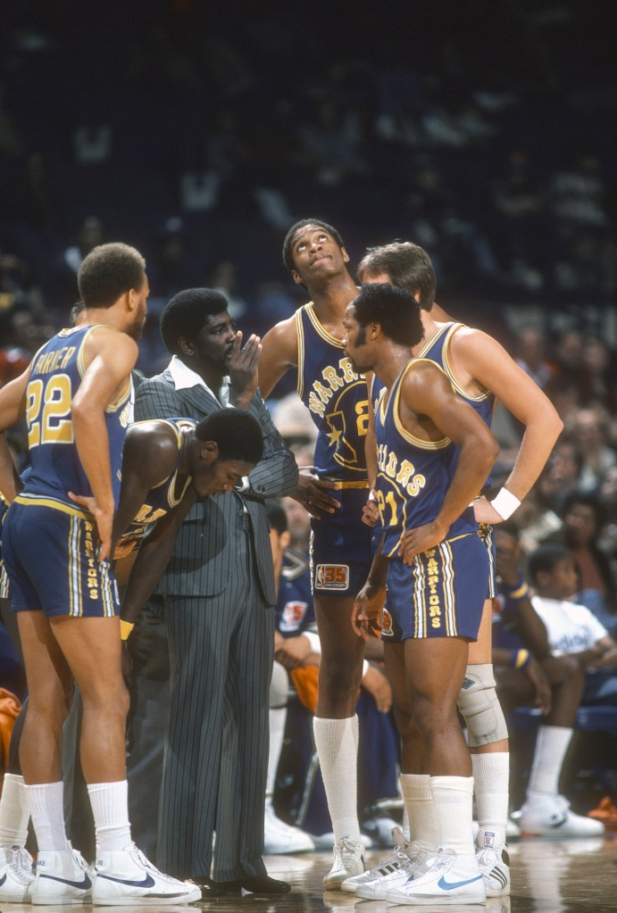 3b5f59c1bad Head coach Al Attles (center) of the Golden State Warriors talks with his  players during a timeout in a game against the Washington Bullets circa  1980 at ...
