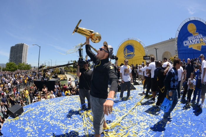 size 40 356dc dc0d1 Stephen Curry  30 of the Golden State Warriors celebrates winning the 2015  NBA Championship during a parade on June 19, 2015 in Oakland, CA.