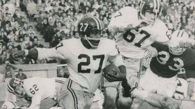 Harvard quarterback John McCluskey,
