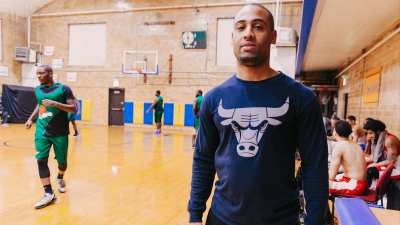 Antwan Green, a coach of the Good Fellas team in the Lace Em Up League, a recreational basketball league in Chicago.
