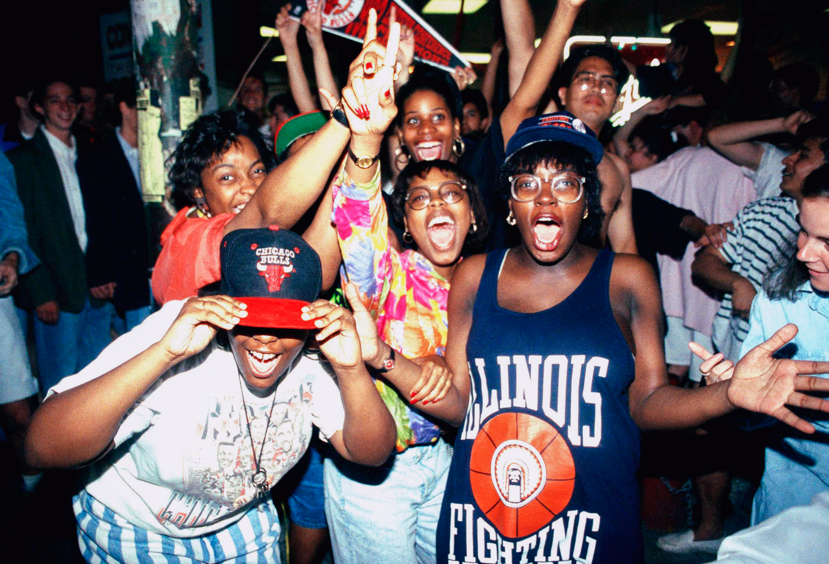 Chicago Bulls fans celebrate the Bulls' 97-93 win over the Portland Trail Blazers, in Chicago on June 14, 1992. The Bulls' second straight NBA title.