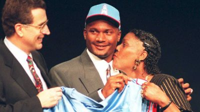 Steve McNair (C) of Alcorn State gets a kiss from