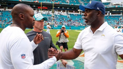 Anthony Lynn and Brian Flores