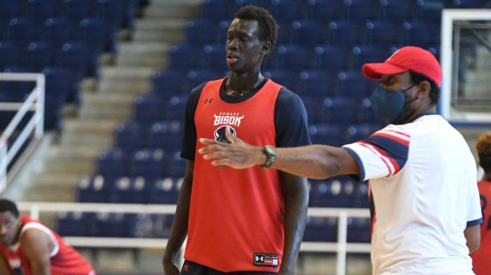 Howard University freshman Makur Maker (center) and men's basketball head coach Kenneth Blakeney (right)